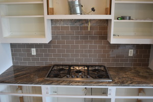 Tiling Over A Granite Backsplash